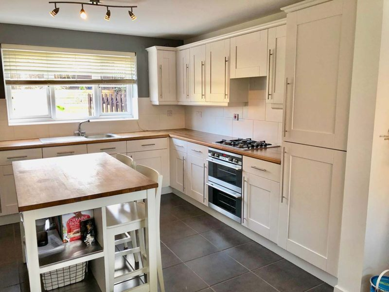 after image of kitchen and island in a clean white