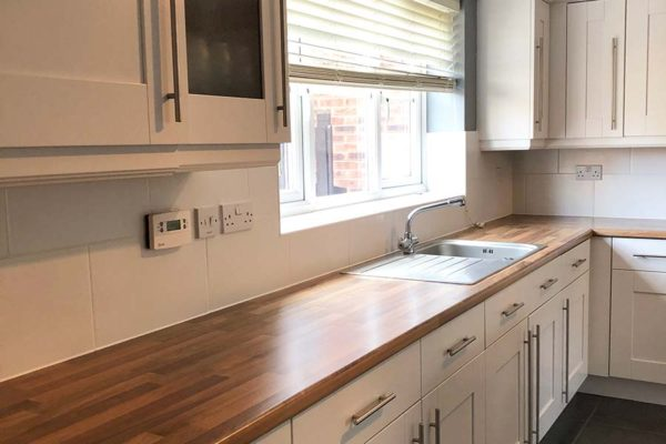 kitchen worktop surface with complimenting white cupboards