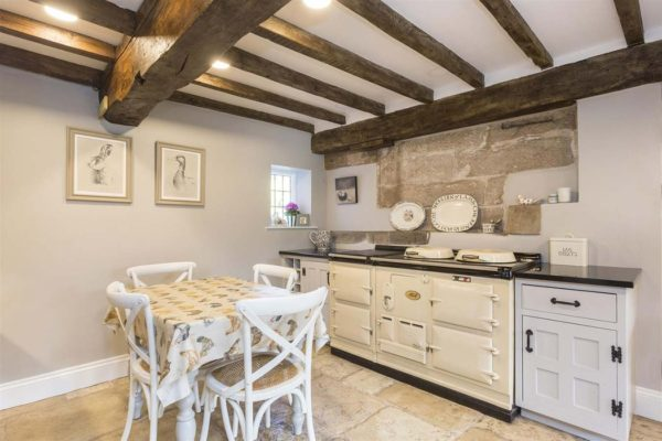cottage kitchen resprayed white with large oven