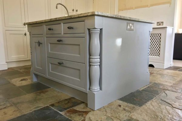 kitchen island resprayed in grey