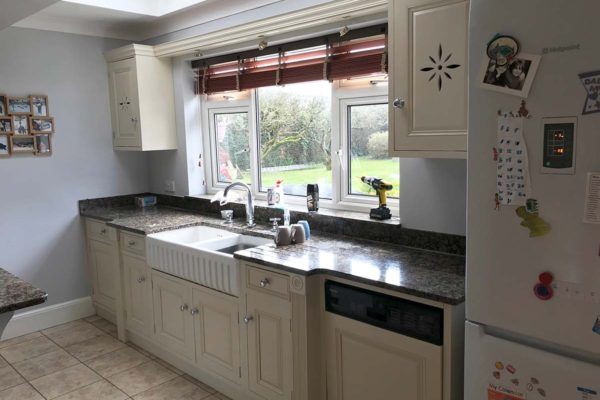 white kitchen sink and cupboards