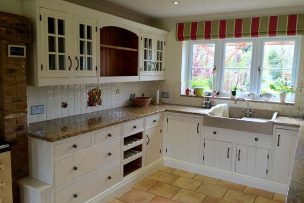 Kitchen resprayed with a clean traditional white look