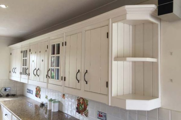 Traditional white sprayed kitchen cupboards